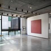 Interior with grey flooring, white walls and red art gallery, exhibition, floor, flooring, interior design, loft, tourist attraction, gray