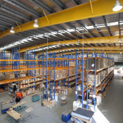 Interior of factory with yellow ceiling beams. - factory, industry, inventory, manufacturing, warehouse