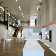 Interior with display kitchen with white cupboards and architecture, ceiling, exhibition, interior design, gray, brown