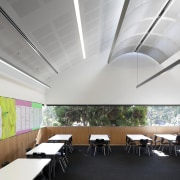 Classrom with light toned walls and ceiling and architecture, ceiling, classroom, conference hall, daylighting, interior design, product design, white