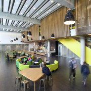 Room with green booth seating and tables. - architecture, institution, interior design, lobby