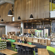 Cafe with black and green booth seating - cafeteria, interior design, brown