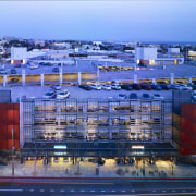 View of parking building at dusk. - View architecture, building, city, cityscape, condominium, daytime, evening, metropolis, metropolitan area, mixed use, port, real estate, reflection, residential area, sky, structure, suburb, urban area, water, teal, blue