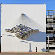 Sculpture on wall. - Sculpture on wall. - architecture, building, facade, sky, structure, tower block, white