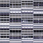 Parking buildling close up. - Parking buildling close building, facade, line, mesh, metal, pattern, purple, steel, structure, white, black