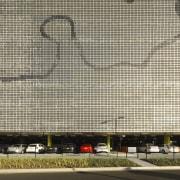 Grey wall and parking lot - Grey wall architecture, building, corporate headquarters, facade, infrastructure, line, metropolis, metropolitan area, residential area, structure, urban area, orange, black