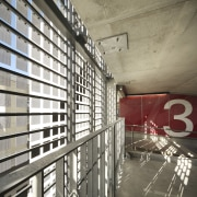 Interior with red wall and number 3. - architecture, building, ceiling, daylighting, interior design, gray, white