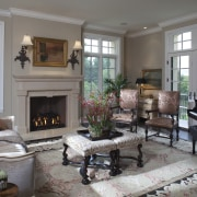 White walls and crown mouldings. Neutral furniture colours. hearth, home, interior design, living room, room, window, gray
