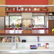 This home was painted with Resene Pohutukawa red, countertop, furniture, interior design, kitchen, shelving, table, gray