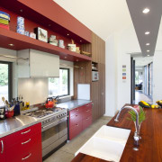 This home was painted with Resene Pohutukawa red, ceiling, countertop, interior design, kitchen, real estate, red, white