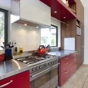 This home was painted with Resene Pohutukawa red, cabinetry, countertop, cuisine classique, interior design, kitchen, real estate, room, gray, red