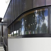 Exterior with curved windows. - Exterior with curved architecture, building, facade, glass, house, window, black, white