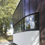 Exterior with curved windows. - Exterior with curved architecture, building, facade, house, window, black