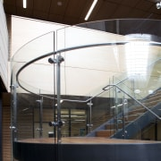 Curved glass of balustrade. - Curved glass of architecture, daylighting, glass, handrail, stairs, structure, tourist attraction, white, black, brown