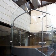 Curved glass of balustrade. - Curved glass of architecture, ceiling, daylighting, glass, interior design, lobby, black, white