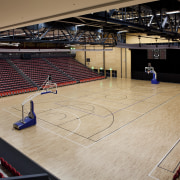Indoor court with black lines and red seats. arena, basketball court, floor, flooring, leisure centre, sport venue, sports, stadium, structure, wood, orange, black