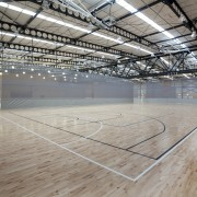 Indoor court with black and white lines. - arena, basketball court, daylighting, floor, flooring, leisure centre, line, sport venue, structure, wood, gray