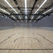 Indoor court with black lines. - Indoor court arena, ceiling, daylighting, floor, flooring, leisure centre, line, sport venue, structure, wood, wood flooring, gray