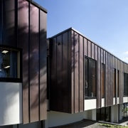 Exterior with dark red cladding. - Exterior with architecture, building, facade, home, house, black