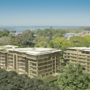 Exterior surrounded by trees. - Exterior surrounded by bird's eye view, condominium, land lot, mixed use, property, real estate, residential area, roof, suburb, brown