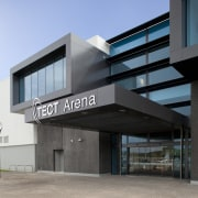Exterior with dark grey cladding and TECT Arena architecture, building, commercial building, corporate headquarters, facade, real estate, gray, teal