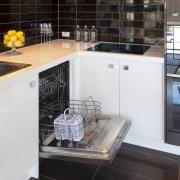 Open dishwasher with brown tiled flooring. - Open architecture, countertop, flooring, interior design, kitchen, room, black, white