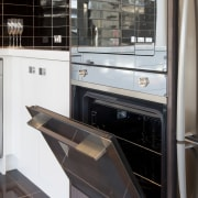 Open oven with brown tiled flooring and white countertop, home appliance, kitchen, kitchen appliance, major appliance, black, white
