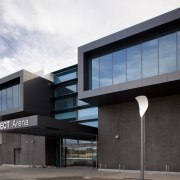 TECT Arena building with dark grey cladding. - architecture, building, commercial building, corporate headquarters, facade, house, property, real estate, black, white