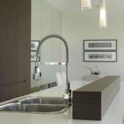 Mirrored walls enhance the light, airy feel of bathroom, bathroom sink, countertop, floor, interior design, kitchen, product design, sink, tap, gray