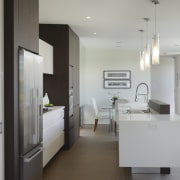 white room is offset by dark brown cabinetry ceiling, floor, house, interior design, product design, real estate, room, gray
