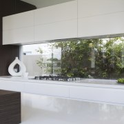 The overhead cabinets in this modern white kitchen architecture, countertop, interior design, kitchen, product design, gray, white