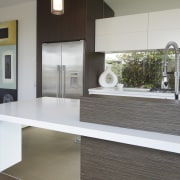 A mirrored finish underneath the kitchen island gives countertop, floor, interior design, real estate, table, gray