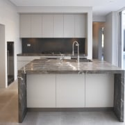 Grey and brown marble island benchtop, white walls, cabinetry, countertop, cuisine classique, floor, flooring, interior design, kitchen, real estate, room, gray