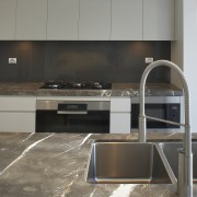 Grey and brown marble island benchtop, white walls, countertop, floor, flooring, interior design, kitchen, tile, gray