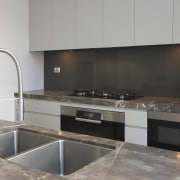 Grey and brown marble island benchtop, white walls, cabinetry, countertop, interior design, kitchen, gray, black