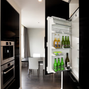 integrated fridge behind dark cabinets - integrated fridge furniture, interior design, kitchen, room, gray, black