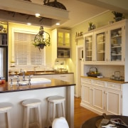 white shelves and cabinetry have traditional furniture look. cabinetry, ceiling, countertop, cuisine classique, dining room, home, interior design, kitchen, room, brown, orange