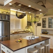 wooden-topped island, stainless refrigerator, hanging rangehood with white cabinetry, ceiling, countertop, cuisine classique, interior design, kitchen, room, brown