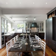 long dining table surrounded by white chairs, wooden countertop, dining room, interior design, kitchen, real estate, room, gray, black