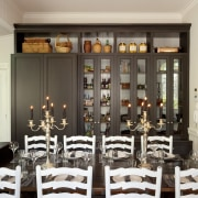 over white chairs and dining table towards grey dining room, function hall, furniture, interior design, restaurant, room, table, gray, black