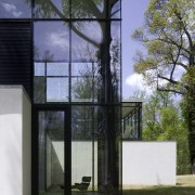 White walls and dark furniture and floors provide architecture, building, facade, house, window, gray, black