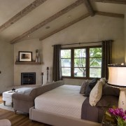 Rustic house modelled on French barn. Interiors feature bedroom, ceiling, estate, interior design, real estate, room, window, brown