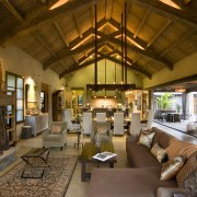 Rustic house modelled on French barn. Interiors feature home, interior design, living room, lobby, room, brown