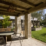 Rustic house modelled on French barn. Interiors feature backyard, cottage, estate, home, house, outdoor structure, patio, property, real estate, yard, brown
