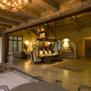 Rustic house modelled on French barn. Interiors feature beam, ceiling, estate, home, interior design, living room, lobby, real estate, room, brown