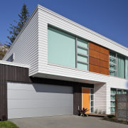 The Palliside weatherboard cladding system provides a clean, architecture, building, elevation, facade, home, house, property, real estate, residential area, siding, window, blue, gray