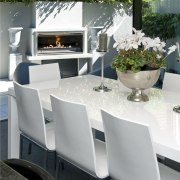 The Moorings in Taupo by Haimes Building fireplace chair, dining room, furniture, interior design, table, gray