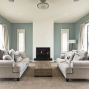 fireplace between two couches, green and white walls ceiling, estate, floor, home, interior design, living room, property, real estate, room, window, white, gray
