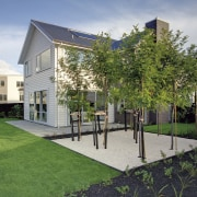 exterior of house from rear, lawn and a architecture, backyard, cottage, courtyard, estate, facade, garden, grass, home, house, landscaping, mixed use, neighbourhood, property, real estate, residential area, roof, villa, yard, gray
