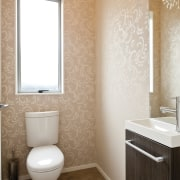 bathroom with toilet and vanity, peach wallpaper - bathroom, bathroom accessory, bathroom sink, bidet, ceramic, floor, flooring, home, interior design, plumbing fixture, room, sink, tile, toilet, toilet seat, wall, white, orange, brown